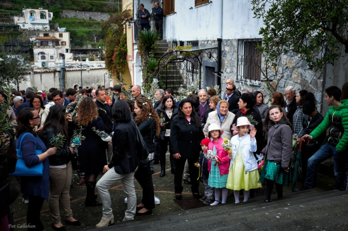 Children gather outside the church on Palm Sunday in Montepertuso Italy
