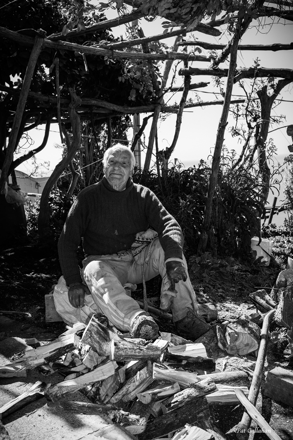 92 year old man in Nocelle Italy chopping wood