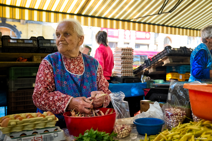 an old woman working at Hunyadi Ter market in Budapest