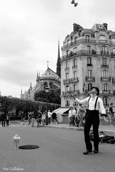 Paris Juggler on Bridge behind Notre Dame